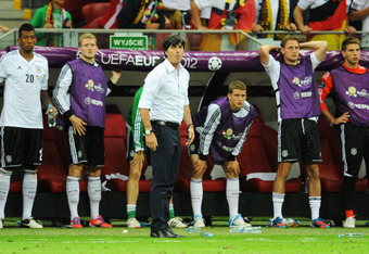WARSAW, POLAND - JUNE 28: Head coach Joachim Loew of Germany watches the action from the touchline during the UEFA EURO 2012 semi final match between Germany and Italy at the National Stadium on June 28, 2012 in Warsaw, Poland.  (Photo by Christopher Lee/