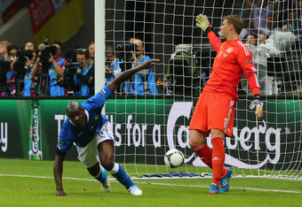 WARSAW, POLAND - JUNE 28:  Mario Balotelli of Italy celebrates scoring the opening goal past Manuel Neuer of Germany during the UEFA EURO 2012 semi final match between Germany and Italy at the National Stadium on June 28, 2012 in Warsaw, Poland.  (Photo b