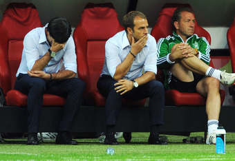 WARSAW, POLAND - JUNE 28: Head coach Joachim Loew (L) of Germany and his assistant coach Hansi Flick (C) show their dejection after the UEFA EURO 2012 semi final match between Germany and Italy at the National Stadium on June 28, 2012 in Warsaw, Poland.