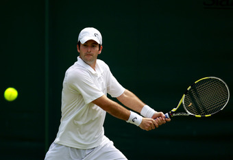 LONDON, ENGLAND - JUNE 26:  Brian Baker of the USA hits a backhand return during his Gentlemen's Singles first round match against Rui Machado Portugal on day two of the Wimbledon Lawn Tennis Championships at the All England Lawn Tennis and Croquet Club o