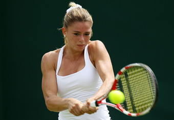 LONDON, ENGLAND - JUNE 25:  Camila Giorgi of Italy returns a backhand shot during her ladies' singles first round match against Flavia Pennetta of Italy on day one of the Wimbledon Lawn Tennis Championships at the All England Lawn Tennis and Croquet Club