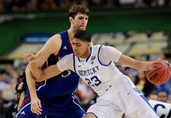 NEW ORLEANS, LA - APRIL 02:  Anthony Davis #23 of the Kentucky Wildcats drives on Jeff Withey #5 of the Kansas Jayhawks in the second half in the National Championship Game of the 2012 NCAA Division I Men's Basketball Tournament at the Mercedes-Benz Super