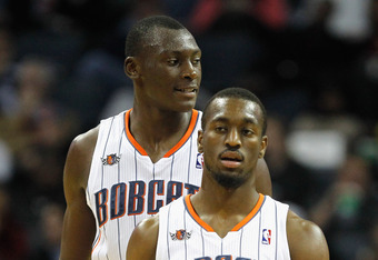 CHARLOTTE, NC - FEBRUARY 10:  Kemba Walker #1 of the Charlotte Bobcats and teammates Bismack Biyombo #0 walk down the court during their game against the Chicago Bulls at Time Warner Cable Arena on February 10, 2012 in Charlotte, North Carolina. NOTE TO U