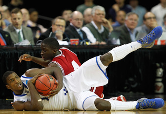 ATLANTA, GA - MARCH 23:  Michael Kidd-Gilchrist #14 of the Kentucky Wildcats and Victor Oladipo #4 of the Indiana Hoosiers vie for a loose ball in the second half during the 2012 NCAA Men's Basketball South Regional Semifinal game at the Georgia Dome on M