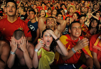 MADRID, SPAIN - JUNE 27:  Spanish fans react while watching on a giant outdoor screen on Paseo de La Castellana street the UEFA EURO 2012 semi-final match between Spain and Portugal on June 27, 2012 in Madrid, Spain.  (Photo by Denis Doyle/Getty Images)