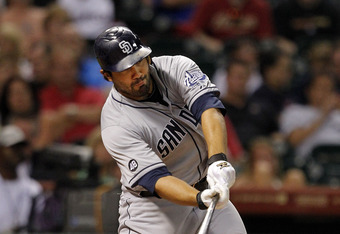 HOUSTON, TX - JUNE 26:  Carlos Quentin #18 of the San Diego Padres singles to center in the seventh inning against the Houston Astros at Minute Maid Park on June 26, 2012 in Houston, Texas. (Photo by Bob Levey/Getty Images)