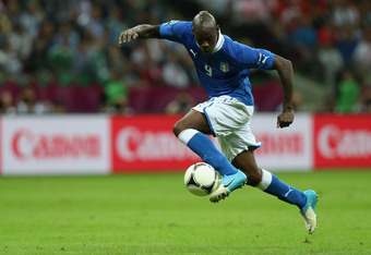 WARSAW, POLAND - JUNE 28:  Mario Balotelli of Italy controls the ball as he runs through to score his team's second goal during the UEFA EURO 2012 semi final match between Germany and Italy at the National Stadium on June 28, 2012 in Warsaw, Poland.  (Pho