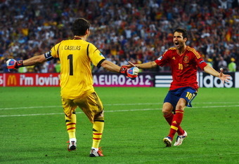 DONETSK, UKRAINE - JUNE 27:  Cesc Fabregas of Spain celebrates scoring the winning penalty with Iker Casillas during the UEFA EURO 2012 semi final match between Portugal and Spain at Donbass Arena on June 27, 2012 in Donetsk, Ukraine.  (Photo by Laurence