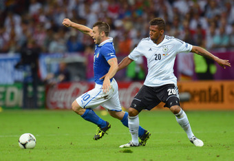 WARSAW, POLAND - JUNE 28:   Antonio Cassano of Italy in action against Jerome Boateng of Germany during the UEFA EURO 2012 semi final match between Germany and Italy at the National Stadium on June 28, 2012 in Warsaw, Poland.  (Photo by Shaun Botterill/Ge