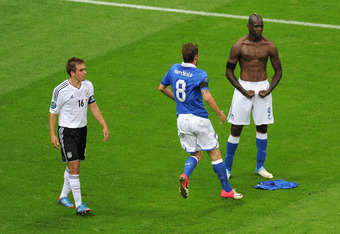 WARSAW, POLAND - JUNE 28:  Mario Balotelli (R) of Italy celebrates with team-mate Claudio Marchisio after scoring his team's second goal as Philipp Lahm of Germany shows his dejection during the UEFA EURO 2012 semi final match between Germany and Italy at