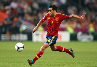 DONETSK, UKRAINE - JUNE 23:  Xavi of Spain crosses the ball during the UEFA EURO 2012 quarter final match between Spain and France at Donbass Arena on June 23, 2012 in Donetsk, Ukraine.  (Photo by Alex Livesey/Getty Images)