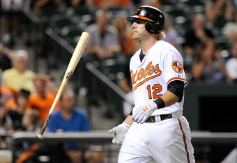 BALTIMORE, MD - AUGUST 31:  Mark Reynolds #12 of the Baltimore Orioles tosses his bat after striking out against the Toronto Blue Jays at Oriole Park at Camden Yards on August 31, 2011 in Baltimore, Maryland.  (Photo by Greg Fiume/Getty Images)