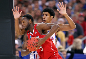 ST. LOUIS, MO - MARCH 23:  C.J. Leslie #5 of the North Carolina State Wolfpack drives against Kevin Young #40 of the Kansas Jayhawks during the 2012 NCAA Men's Basketball Midwest Regional Semifinal at Edward Jones Dome on March 23, 2012 in St. Louis, Miss