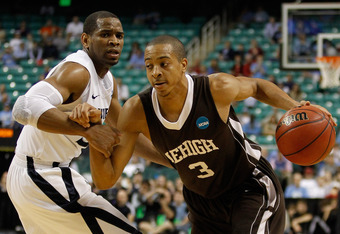 GREENSBORO, NC - MARCH 18:  C.J. McCollum #3 of the Lehigh Mountain Hawks drives on Tu Holloway #52 of the Xavier Musketeers in the second half during the third round of the 2012 NCAA Men's Basketball Tournament at Greensboro Coliseum on March 18, 2012 in