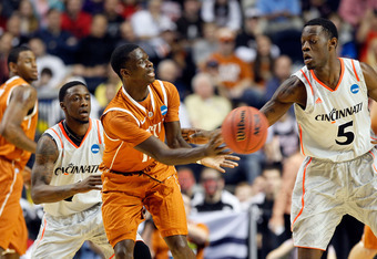 NASHVILLE, TN - MARCH 16:  Myck Kabongo #12 of the Texas Longhorns passes the ball against the Cincinnati Bearcats during the second round of the 2012 NCAA Men's Basketball Tournament at Bridgestone Arena on March 16, 2012 in Nashville, Tennessee.  (Photo