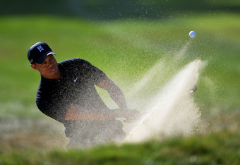 SAN FRANCISCO, CA - JUNE 15:  Tiger Woods of the United States plays a bunker shot on the 16th hole during the second round of the 112th U.S. Open at The Olympic Club on June 15, 2012 in San Francisco, California.  (Photo by Stuart Franklin/Getty Images)