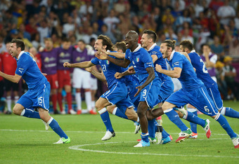 KIEV, UKRAINE - JUNE 24:  Mario Balotelli and Andrea Pirlo of Italy (C) celebrates with team-mates after victory during the UEFA EURO 2012 quarter final match between England and Italy at The Olympic Stadium on June 24, 2012 in Kiev, Ukraine.  (Photo by C