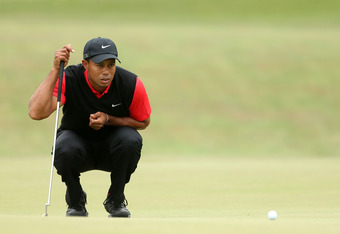 SAN FRANCISCO, CA - JUNE 17:  Tiger Woods of the United States lines up a putt on the first hole during the final round of the 112th U.S. Open at The Olympic Club on June 17, 2012 in San Francisco, California.  (Photo by Andrew Redington/Getty Images)