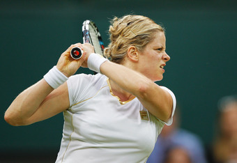LONDON, ENGLAND - JUNE 27:  Kim Clijsters of Belgium in action during her Ladies' singles second round match against Andrea Hlavackova of Czech Republic on day three of the Wimbledon Lawn Tennis Championships at the All England Lawn Tennis and Croquet Clu