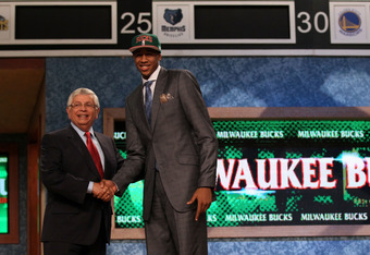 NEWARK, NJ - JUNE 28:  John Henson (R) of the North Carolina Tar Heels greets NBA Commissioner David Stern (L) after he was selected number fourteen overall by the Milwaukee Bucks during the first round of the 2012 NBA Draft at Prudential Center on June 2