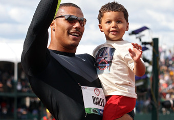 EUGENE, OR - JUNE 24:  Ryan Bailey celebrates with his son Tyree after coming in third in the men's 100 meter final on Day Three of the 2012 U.S. Olympic Track & Field Team Trials at Hayward Field on June 24, 2012 in Eugene, Oregon.  (Photo by Christian P
