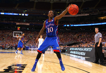 ST LOUIS, MO - MARCH 25:  Tyshawn Taylor #10 of the Kansas Jayhawks reaches to keep a ball in bounds against the North Carolina Tar Heels during the 2012 NCAA Men's Basketball Midwest Regional Final at Edward Jones Dome on March 25, 2012 in St Louis, Miss