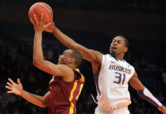 NEW YORK, NY - MARCH 27:  Terrence Ross #31 of the Washington Huskies blocks the shot by Andre Hollins #1 of the Minnesota Golden Golphers in the second half during the semifinals of the 2012 NCAA NIT Men's Basketball Championship at Madison Square Garden