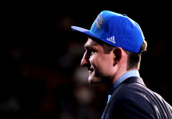 NEWARK, NJ - JUNE 28:  Tyler Zeller (R) of the North Carolina Tar Heels walks on stage after he was selected number seventeen overall by the Minnesota Timberwolves during the first round of the 2012 NBA Draft at Prudential Center on June 28, 2012 in Newar