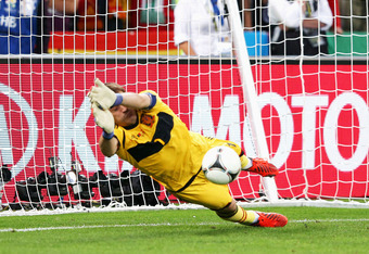 DONETSK, UKRAINE - JUNE 27: Iker Casillas of Spain saves a penalty from Joao Moutinho of Portugalduring the UEFA EURO 2012 semi final match between Portugal and Spain at Donbass Arena on June 27, 2012 in Donetsk, Ukraine.  (Photo by Alex Livesey/Getty Ima