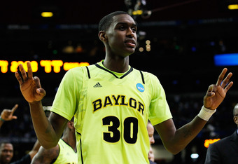 ATLANTA, GA - MARCH 23:  Quincy Miller #30 of the Baylor Bears cleebrates during their 75 to 70 win over the Xavier Musketeers during the 2012 NCAA Men's Basketball South Regional Semifinal game at the Georgia Dome on March 23, 2012 in Atlanta, Georgia.
