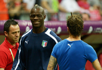 WARSAW, POLAND - JUNE 28:  Mario Balotelli of Italy smiles as he celebrates victory after the UEFA EURO 2012 semi final match between Germany and Italy at National Stadium on June 28, 2012 in Warsaw, Poland.  (Photo by Claudio Villa/Getty Images)