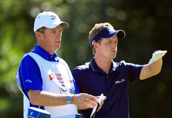 Luke Donald consults with caddie at Children's Miracle Network