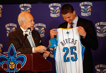 NEW ORLEANS, LA - JUNE 29:  Team owner Tom Benson of the New Orleans Hornets presents Austin Rivers, the 10th overall pick in the NBA draft his jersey for the New Orleans Hornets at the New Orleans Arena on June 29, 2012 in New Orleans, Louisiana.  (Photo