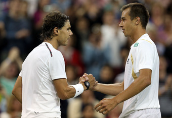 LONDON, ENGLAND - JUNE 28:  Lukas Rosol of the Czech Republic shakes hands with  Rafael Nadal of Spain after defeating him during their Gentlemen's Singles second round match on day four of the Wimbledon Lawn Tennis Championships at the All England Lawn T