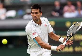 LONDON, ENGLAND - JUNE 29:  Novak Djokovic of Serbia hits a backhand return during his Gentlemen's Singles third round match against Radek Stepanek of Czech Republic on day five of the Wimbledon Lawn Tennis Championships at the All England Lawn Tennis and