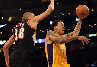 LOS ANGELES, CA - FEBRUARY 20:  Matt Barnes #9 of the Los Angeles Lakers scores on a layup in front of Nicolas Batum #88 of the Portland Trail Blazers during the first half at Staples Center on February 20, 2012 in Los Angeles, California.  NOTE TO USER: