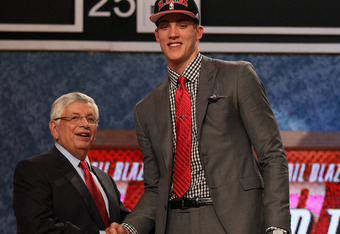NEWARK, NJ - JUNE 28:  Meyers Leonard (R) of the Illinois Fighting Illini greets NBA Commissioner David Stern (L) after he was selected number eleven overall by Portland Trail Blazers during the first round of the 2012 NBA Draft at Prudential Center on Ju