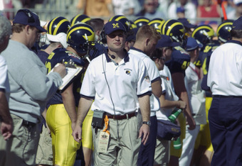 TAMPA, FL - JANUARY 1:  Quarterbacks coach Scot Loeffler of the Michigan Wolverines walks on the sidelines during the game against the Florida Gators in the Outback Bowl at Raymond James Stadium on January 1, 2003 in Tampa, Florida.  The Wolverines defeat