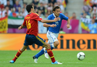 GDANSK, POLAND - JUNE 10:  Andrea Pirlo of Italy goes past Sergio Busquets of Spain during the UEFA EURO 2012 group C match between Spain and Italy at The Municipal Stadium on June 10, 2012 in Gdansk, Poland.  (Photo by Shaun Botterill/Getty Images)