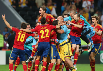 DONETSK, UKRAINE - JUNE 27:  Cesc Fabregas of Spain celebrates scoring the winning penalty with team-mates during the UEFA EURO 2012 semi final match between Portugal and Spain at Donbass Arena on June 27, 2012 in Donetsk, Ukraine.  (Photo by Martin Rose/