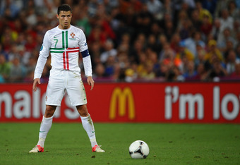 DONETSK, UKRAINE - JUNE 27: Cristiano Ronaldo of Portugal prepares to take a free kick during the UEFA EURO 2012 semi final match between Portugal and Spain at Donbass Arena on June 27, 2012 in Donetsk, Ukraine.  (Photo by Laurence Griffiths/Getty Images)