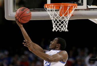 NEW ORLEANS, LA - APRIL 02:  Marquis Teague #25 of the Kentucky Wildcats lays the ball up against the Kansas Jayhawks in the first half in the National Championship Game of the 2012 NCAA Division I Men's Basketball Tournament at the Mercedes-Benz Superdom