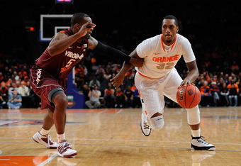 NEW YORK, NY - NOVEMBER 23:  Kris Joseph #32 of the Syracuse Orange drives the ball against Dorenzo Hudson #5 of the Virginia Tech Hokies of the Virginia Tech Hokies during the 2011 Dick's Sporting Goods NIT Season Tip-Off at Madison Square Garden on Nove