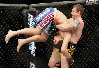 MONTREAL- MAY 8: Alan Belcher (R) holds on to Patrick Cote in their middleweight bout at UFC 113 at Bell Centre on May 8, 2010 in Montreal, Quebec, Canada.  (Photo by Richard Wolowicz/Getty Images)
