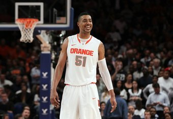 NEW YORK, NY - MARCH 08:  Fab Melo #51 of the Syracuse Orange looks on against the Connecticut Huskies during their quarterfinal game of the 2012 Big East Men's Basketball Tournament at Madison Square Garden on March 8, 2012 in New York City.  (Photo by J