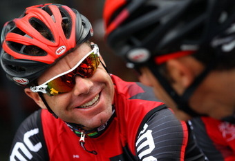 LIEGE, BELGIUM - JUNE 29:  (L-R) Defending champion Cadel Evans of Australia riding for BMC Racing chats with teammate George Hincapie of the USA before commencing a training ride in preparation for the 2012 Tour de France on June 29, 2012 in Liege, Belgi