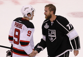 LOS ANGELES, CA - JUNE 11:  Zach Parise #9 of the New Jersey Devils shakes hands with Jeff Carter #77 of the Los Angeles Kings after Game Six of the 2012 Stanley Cup Final at Staples Center on June 11, 2012 in Los Angeles, California. The Kings defeated t