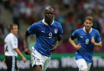 WARSAW, POLAND - JUNE 28:  Mario Balotelli of Italy celebrates scoring the opening goal during the UEFA EURO 2012 semi final match between Germany and Italy at the National Stadium on June 28, 2012 in Warsaw, Poland.  (Photo by Joern Pollex/Getty Images)