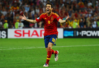 DONETSK, UKRAINE - JUNE 27:  Cesc Fabregas of Spain celebrates scoring the winning penalty  during the UEFA EURO 2012 semi final match between Portugal and Spain at Donbass Arena on June 27, 2012 in Donetsk, Ukraine.  (Photo by Laurence Griffiths/Getty Im