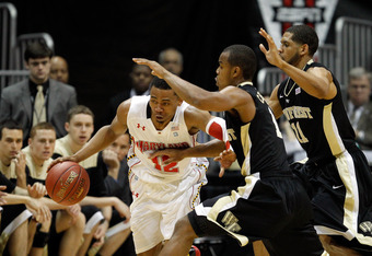ATLANTA, GA - MARCH 08:  Terrell Stoglin #12 of the Maryland Terrapins drives against Tony Chennault #1 of the Wake Forest Demon Deacons during their first round game of 2012 ACC Men's Basketball Conferene Tournament at Philips Arena on March 8, 2012 in A